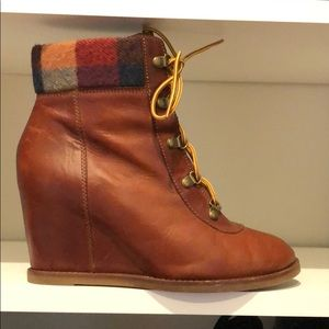 Soft leather brown lace up wedge booties.